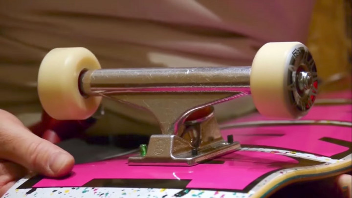 Close up of skateboard truck and wheels