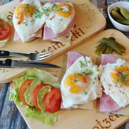 Close up of ham and eggs on pitta bread
