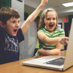 Virtual Team Building Children Cheering by Laptop
