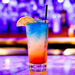 Brightly Coloured Cocktail on blurry background