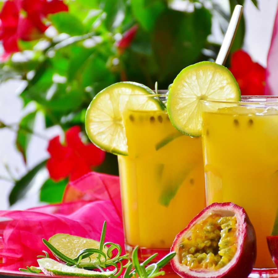Two orange smoothies with a flowered background