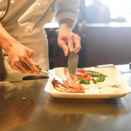Chef placing food onto a plate
