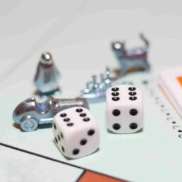 Monopoly dice and playing pieces