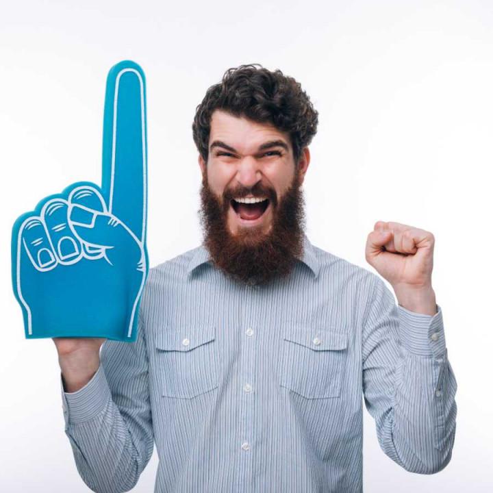 Man holding upa big foam hand