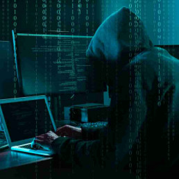 Virtual Team Building Spy at Computer