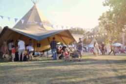 Corporate away day people in brown large tipi