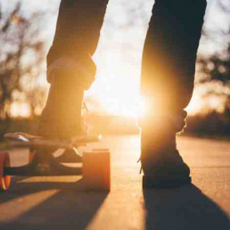 Person on skateboard for charity virtual Christmas party