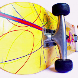 Close up of the bottom of a yellow skateboard with swirly line pattern